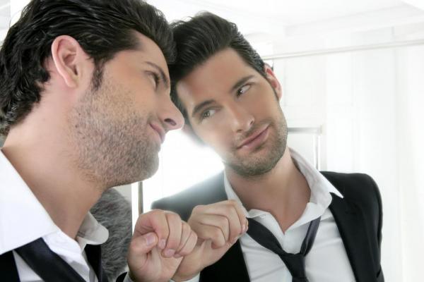 man-liking-himself-in-mirror