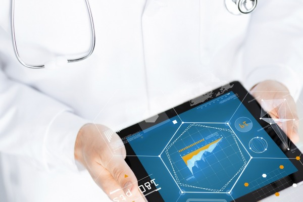 medicine, technology and people concept - close up of doctor holding tablet pc with ghaph on screen