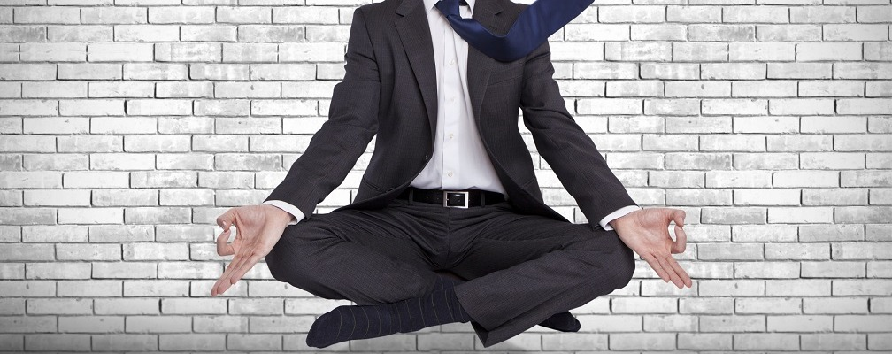 young businessman levitating in yoga position, meditation